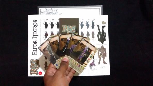 As cartas-teste e a flha de miniaturas montáveis da série Elfos negros para RPGQuest Boradgame